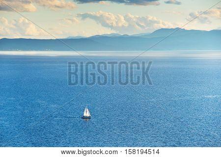 Sail Boat On A Lake
