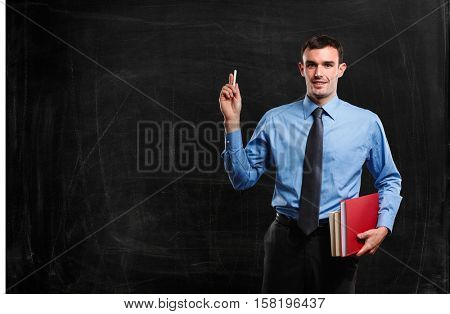 Portrait of a man in front of a blackboard