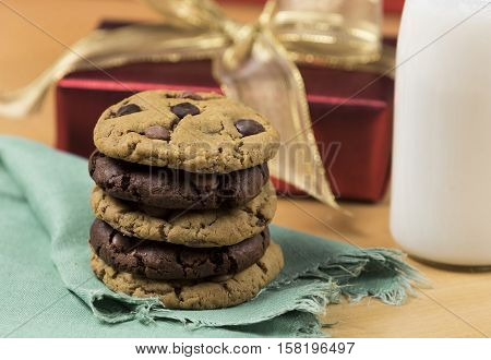 Cookies and Milk for Santa / Cookies and milk with Christmas decoration on a wooden background