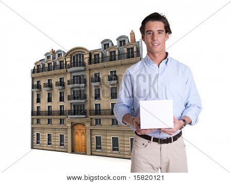 Young man holding a blank box with a Parisian building at the background