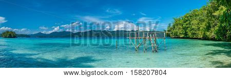 Fisherman Platform near Batu Lima, Biodiversity Resort, Gam Island, Doberai Eco in Background, Urai , West Papuan, Raja Ampat, Indonesia.