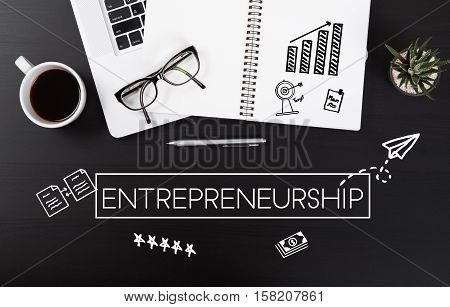 Modern Office desk with Entrepreneurship homepage on the table. strategy business plan brainstorming concept.