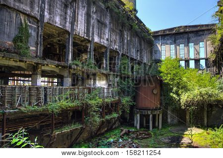 Abandoned, destroyed by war and overgrown machinery of Tkvarcheli (Tquarchal) power plant, Abkhazia, Georgia