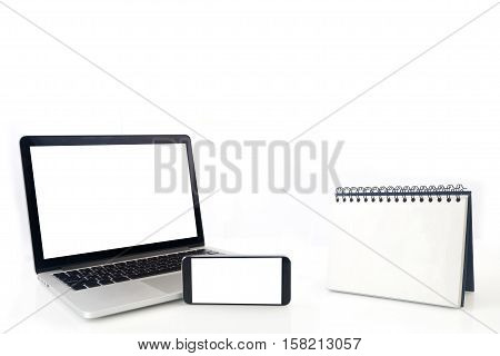 Desktop Loop wire binding book and blank screen of notebook cell phone tablet smartphone on isolated white background. concept of business connection.