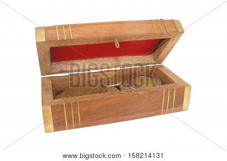 Wooden casket with coins of different countries on white background