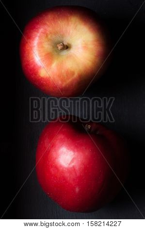 red apple fruts on a black background