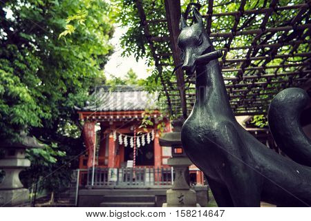 Tokyo - May 2016: Japanese wooden shrine with statue of fox. Nakano