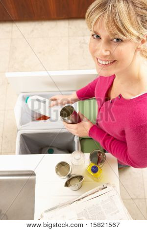 Woman Recyling Waste At Home