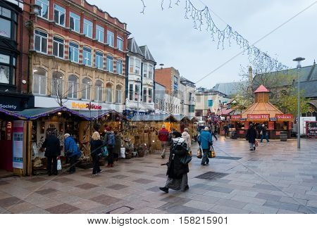 Cardiff Wales United Kingdom - November 23 2016: Locals and tourists shopping and visiting the Christmas Market in Cardiff City Center