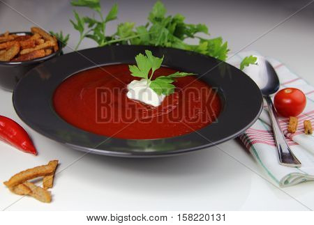 tomato cream soup with sour cream and croutons