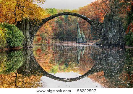 Rakotz Bridge (rakotzbrucke, Devil's Bridge) In Kromlau, Saxony, Germany. Colorful Autumn, Reflectio