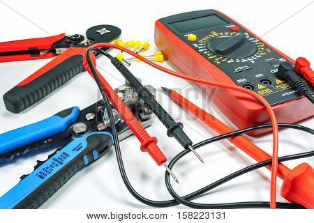 Tools and equipment for electrical work on a white background