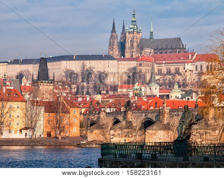 Sunny morning view of Prague Castle in Hradcany, Prague, Czech Republic. Statue of Bedrich Smetana on the foreground.