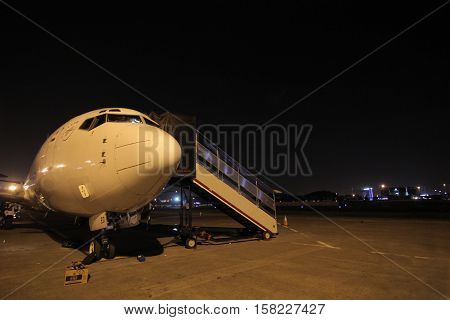 Passenger Airplane at the terminal gate, prepare and maintenance aircraft for night flight