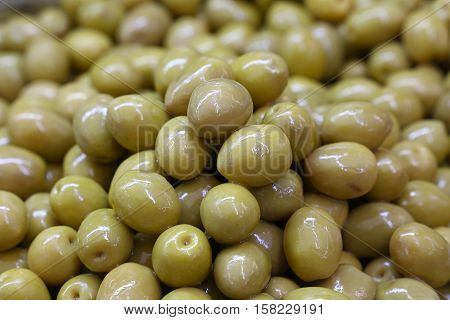 Green Whole Olives In Oil Close Up