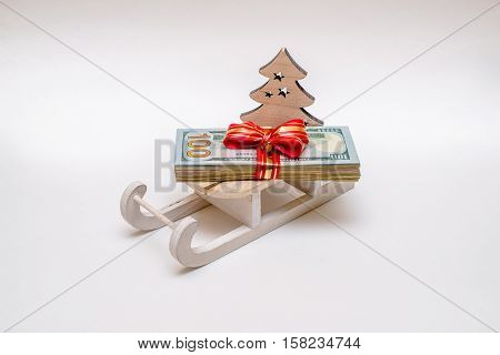sled with lying on a pack of them American currency