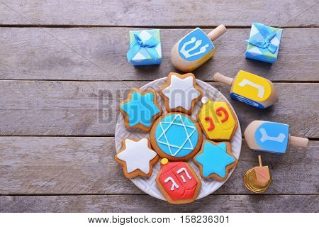 Beautiful composition of tasty cookies for Hanukkah on wooden table
