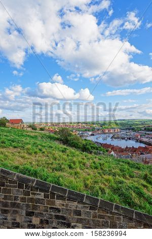 Coast of North Sea in Whitby in North Yorkshire in the UK. It is a seaside port and town on the coast of the river Esk.