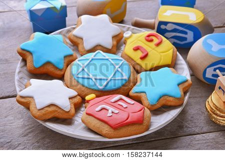 Plate with tasty cookies for Hanukkah on wooden table, closeup