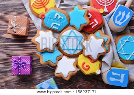Beautiful composition for Hanukkah on wooden table, closeup