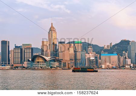Container Ship At Victoria Harbor In Hong Kong At Sunset