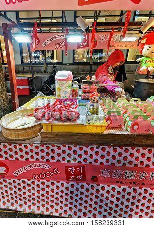 Female Seller Of Mochi In Myeongdong Street Market In Seoul