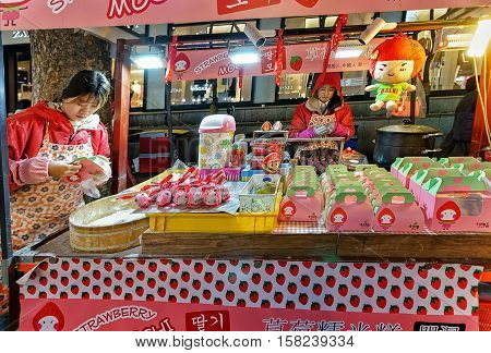 Female Sellers Of Mochi At Myeongdong Street Market In Seoul