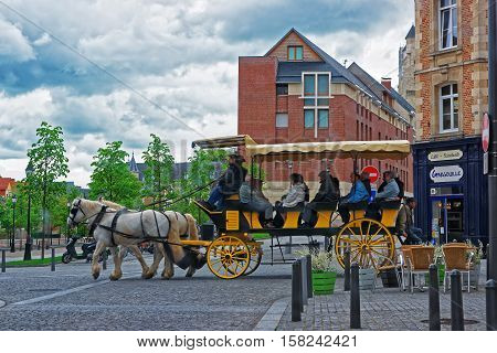 Amiens France - May 9 2012: Horse Carriage with tourists in the city center of Amiens Picardy in France.