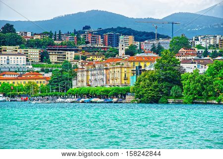 Houses At Lake Lugano And Mountains In Ticino In Switzerland