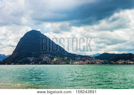 Lake Lugano And Alps Mountains In Ticino Switzerland