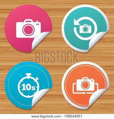 Round stickers or website banners. Photo camera icon. Flip turn or refresh symbols. Stopwatch timer 10 seconds sign. Circle badges with bended corner. Vector