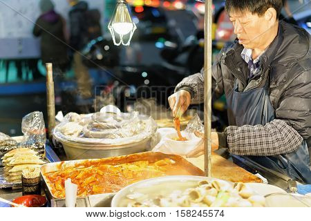 Man Selling Food In Myeongdong Open Street Market In Seoul