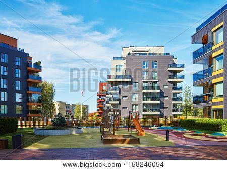Modern Complex Of Apartment Residential Buildings And Children Playground