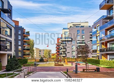Modern Complex Of Residential Buildings And Playground