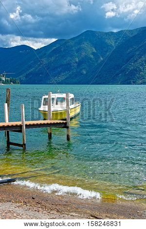 Motor Boat At Landing Stage In Lugano In Ticino Switzerland