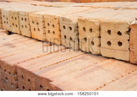 The red brick building Is important in the construction of walls of buildings.