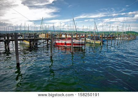 Pier With Boats At Reichenau Island And Lake Constance