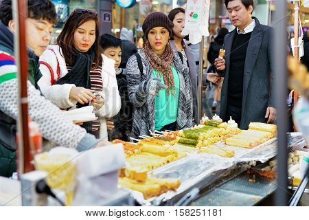 Purchase Of Food On Skewers At Myeongdong Open Street Market