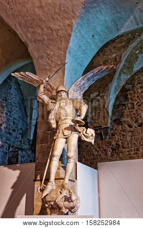 Mont Saint-Michel France - May 8 2012: Sculpture of St Michel with wings fighting and defeating dragon Mont Saint Michel of Normandy region at Manche department in France.