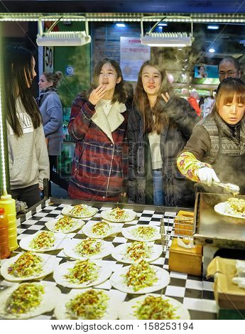 Seller And Buyers In Myeongdong Open Street Market In Seoul