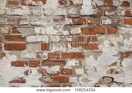 Old Vintage Red Brick Wall With Crashed White Plaster Texture Background. White Red Retro Brick Wall Horizontal Textured Background. Grungy Street Exterior Wall Surface. Abstract Urban Rough Pattern. Urban Brickwal Closeup