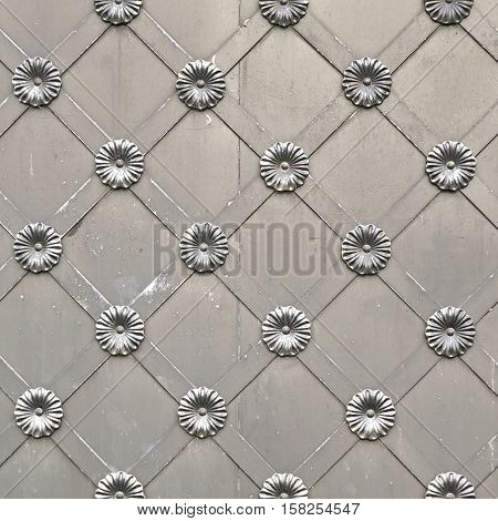 Old Silver Metal Gate Or Door With Iron Forged Decorative Grid Ornament Square Background. Gray Castle Gate Vintage Frame Aged Texture. Monastery Gate Grey Surface. Convent Or Abbey Door Structure