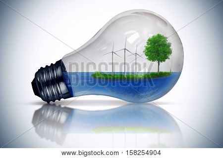 Light bulb as a micro planet with blue water and a island with green grass and tree growing inside. Windmill generator as the symbol of energy conservation and environmental friendly concept isolated on white.