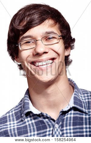 Face close up of young hispanic man wearing glasses and blue shirt smiling perfect healthy toothy smile over white background - dentistry or ophthalmology concept