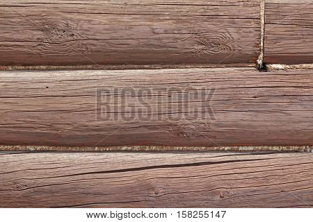 Modern Hand Hewn Natural Log Cabin Wall Facade Fragment Texture. Rustic Log Wall Horizontal Timber Background. Fragment Of Unpainted Wooden Debarked Logs Barn Or House Wood Wall Background Texture