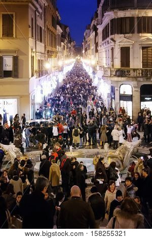 Rome Italy - December 26 2008: Crowd in Via dei Condotti for Christmas shopping near the Spanish Steps. The road appears decked out with lights and the Christmas decorations.