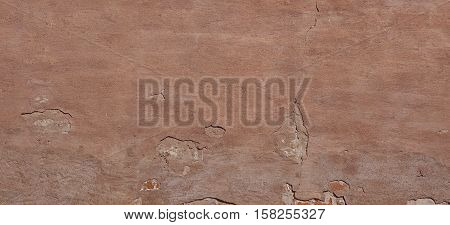 Dark Plaster Wall With Dirty Red Brown Scratched Horizontal Background. Old Brickwall With Peel Rusty Stucco Texture. Retro Vintage Worn Wall Textured Background. Decay Crack Rough Abstract Banner Surface.