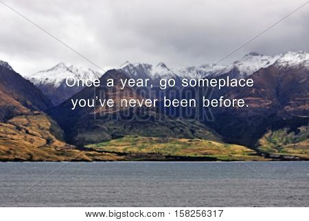 Inspirational Quote - Once A Year Go Someplace You're Never Been Before, Blurry Background With Retr