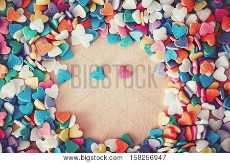 Heap of colorful candies confetti of heart shape blue and pink pair couple hearts romantic date copy space for text Valentine Day holiday concept toned with filters retro vintage effect