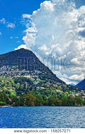 Swiss Houses At Lake Lugano And Alps Mountains Ticino Switzerland